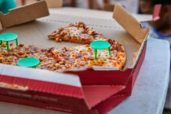 Italian pizza with tomato sauce in opened cardboard box stock photos