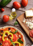Italian pizza with tomatoes, olive oil, and chesse Stock Photos