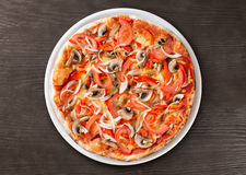 Italian pizza top view on table Stock Image