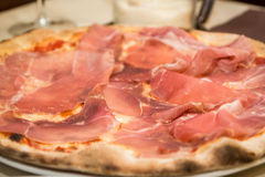 Italian pizza topped with prosciutto close-up Stock Photography
