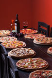 Italian Pizza and wine. On wooden table Stock Images