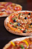 Italian Pizza. On wooden table Stock Images
