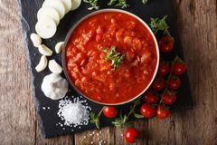 Italian pizzaiola sauce with ingredients close-up. horizontal to. Italian pizzaiola sauce with ingredients close-up on the table. horizontal top view from above Stock Image