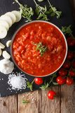 Italian pizzaiola sauce with ingredients close-up. Vertical top. Italian pizzaiola sauce with ingredients close-up on the table. Vertical top view from above Royalty Free Stock Image