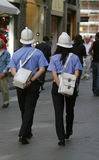 Italian Police. Two Italian police officers, one male one female, patrol the streets of an Italian city Royalty Free Stock Photography