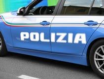 Italian police car with great written POLIZIA patrols the street Royalty Free Stock Photos