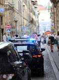 Italian police car with lights and siren in the city. Police car with lights and siren in the city full of people stock images