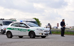 Italian police car and policeman. On regional general strike in Brianza, 20 April, 2012, Italy Royalty Free Stock Photo