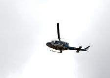 Italian police helicopter flying over the city Stock Photography