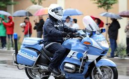 Italian police motorcycle with COP in the rain Stock Images