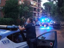 Italian police officers in action. Rome, Italy - August 9, 2018: Italian police in action. The Polizia di Stato is one of the national police forces of Italy stock images