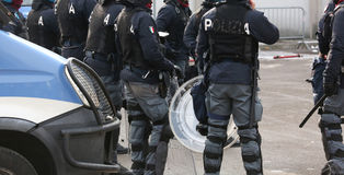 Italian police officers in riot gear with the word POLIZIA meani Stock Image