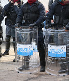 Italian police officers in riot gear with the word POLIZIA meani Stock Photos