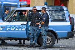 The Italian police officers at the squad car. Italy Royalty Free Stock Photo