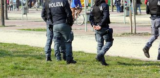 Italian police patrolling the Park in search of drug dealers. Italian police team patrolling the Park in search of drug dealers Royalty Free Stock Image