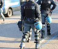 Italian police in riot gear with flak jackets and protective hel. Mets and batons billy Royalty Free Stock Photography