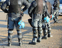 Italian police in riot gear with flak jackets and protective hel. Mets and batons billy Royalty Free Stock Photos