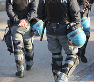 Italian police in riot gear with flak jackets and protective hel. Mets and billy Stock Photos