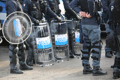 Italian Police with shields and riot gear during the event in the city Stock Photos