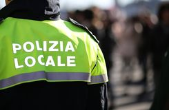 Italian policeman with police uniform patrol the city Stock Images