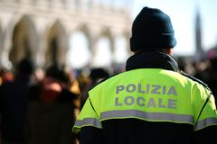 Italian policeman with police uniform patrol in venice Royalty Free Stock Photo