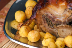 Italian Porchetta with New Potatoes Stock Photos