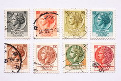 Italian postage stamps. Used Italian postage stamps depicting an ancient coin royalty free stock photography