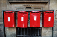 Italian postboxes. Four italian red postboxes on a wall Royalty Free Stock Photography