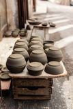 Italian pots. Some crockery arranged on the street in a typical italian artisan shop royalty free stock photography