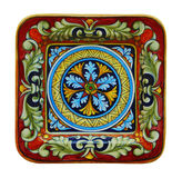 Italian pottery. Traditional ceramic italian plate with multicolor ornaments Royalty Free Stock Photos