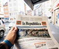Italian press, la republica, 2017 Las Vegas Strip shooting newsp. PARIS, FRANCE - OCT 3, 2017: Man buying Italian La Repubblica newspaper with socking title and Royalty Free Stock Image