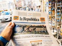 Italian press, la republica, 2017 Las Vegas Strip shooting newsp. PARIS, FRANCE - OCT 3, 2017: Man buying Italian La Repubblica newspaper with socking title and Stock Image