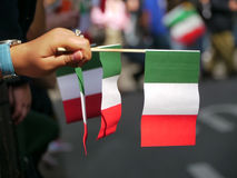 Italian Pride. A spectator  holding Italian flags on Royalty Free Stock Images