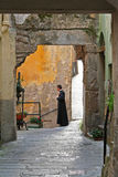 Italian Priest in small streets Royalty Free Stock Images