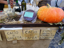 Italian Products In Sale. ORIOLO ROMANO, ITALY - SEPTEMBER 25, 2016: Italian cheese, wines, schnapps and pumpkins in sale on stand with the occasion of Porcini royalty free stock images