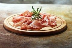 Italian prosciutto crudo or jamon with parsley. Raw ham.  royalty free stock image