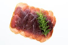 Italian prosciutto crudo or jamon. Raw ham. Isolated on white ba. Ckground Stock Images