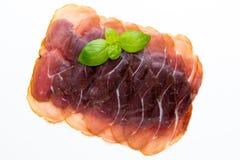Italian prosciutto crudo or jamon. Raw ham. Isolated on white ba. Ckground Stock Photo