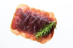 Italian prosciutto crudo or jamon. Raw ham. Isolated on white ba. Ckground Royalty Free Stock Photography