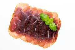 Italian prosciutto crudo or jamon. Raw ham. Isolated on white ba. Ckground Stock Photos