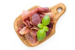 Italian prosciutto crudo or jamon. Raw ham. Isolated on white ba. Ckground Royalty Free Stock Images