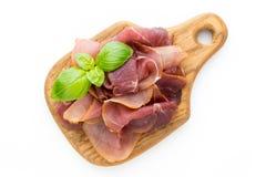 Italian prosciutto crudo or jamon. Raw ham. Isolated on white ba. Ckground Royalty Free Stock Photos