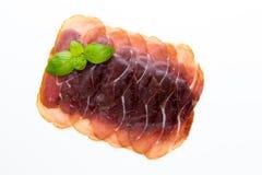 Italian prosciutto crudo or jamon. Raw ham.  on white ba. Ckground Royalty Free Stock Images