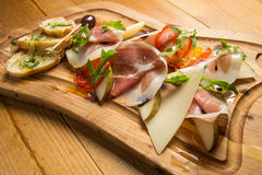 Italian prosciutto, cured pork meat Stock Images