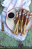 Italian prosciutto ham grissini bread sticks. A plate with italian prosciutto ham grissini bread sticks stock photos