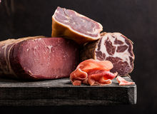 Italian prosciutto. On rustic background Royalty Free Stock Image