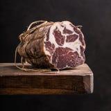Italian prosciutto. On rustic background Stock Photo