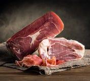 Italian prosciutto. On rustic background Stock Image