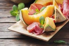 Italian prosciutto with sweet fresh melon Stock Image