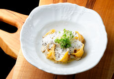 Italian pumpkin ravioli tortellini with Porcini mushrooms Stock Images